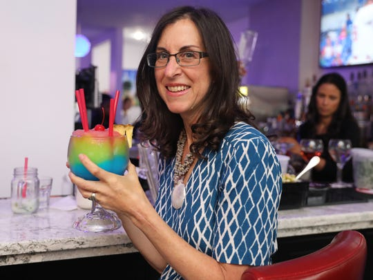 "Jeanne Muchnick, the food and dining reporter for lohud.com, shows off The Threesome frozen drink combo, during a ""Dinner with Jeanne"" event at Don Coqui On The Hudson in Haverstraw, June 27, 2018."