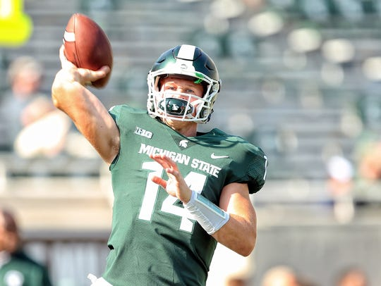 Michigan State Spartans quarterback Brian Lewerke (14)
