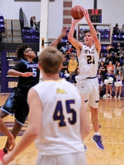 Wylie's Dylan Isenhower takes and makes a 3-point shot