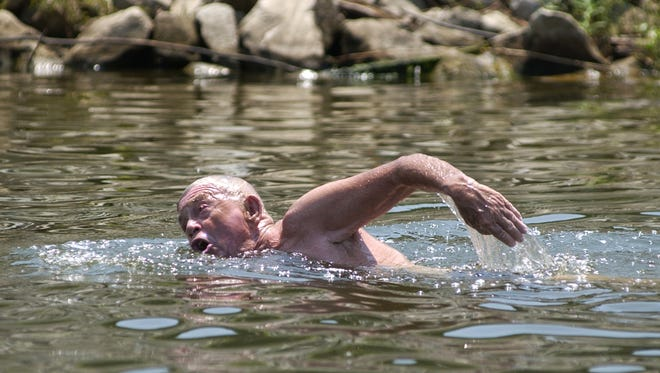 Harry Briggs is shown during his two-mile swim in the Red River near Alexandria in 2006. Briggs, a professor who raised money for Northwestern State University with open water swimming challenges into his 90s, passed away over the weekend.