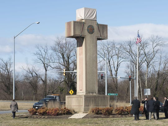 Visitors walk around the 40-foot Maryland Peace Cross