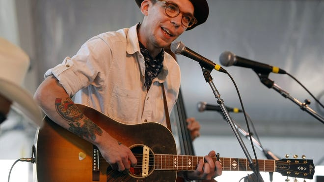 Singer-songwriter Justin Townes Earle performs at the Newport Folk Festival in Newport, R.I., in 2011. Earle, a leading performer of American roots music known for his introspective and haunting style, has died at age 38.