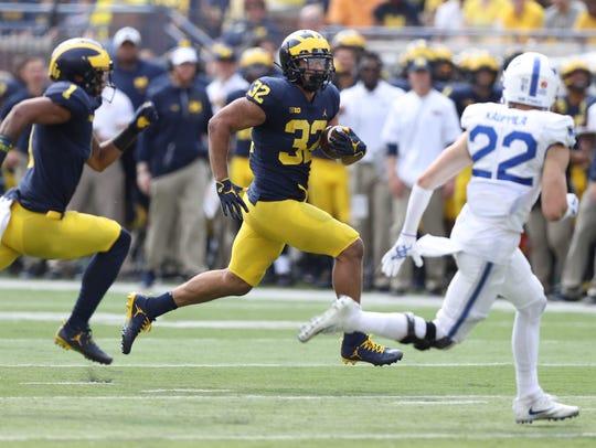 Michigan's Ty Isaac runs the ball against Air Force