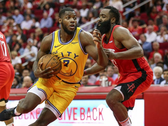 Nov 6, 2019; Houston, TX, USA; Golden State Warriors forward Eric Paschall (7) drives with the ball as Houston Rockets guard James Harden (13) defends during the second quarter at Toyota Center. Mandatory Credit: Troy Taormina-USA TODAY Sports