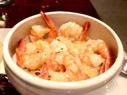 The camarones al ajillo ($18) features shrimp sauteed in garlic sauce.
