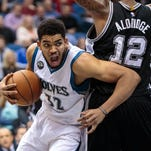 Minnesota Timberwolves center Karl-Anthony Towns (32) drives around San Antonio Spurs forward LaMarcus Aldridge (12) in the second quarter Tuesday at Target Center in Minneapolis.