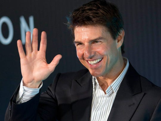 Tom Cruise waves to fans in 2013.