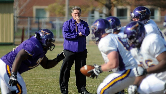 Minnesota State-Mankato football coach Todd Hoffner watches drills.