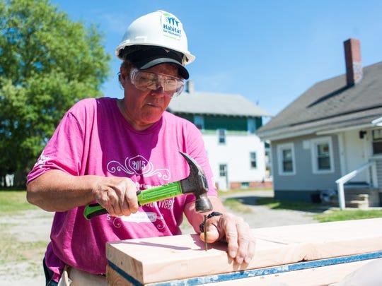 Margaret Bush works to build a home on Naylor Street