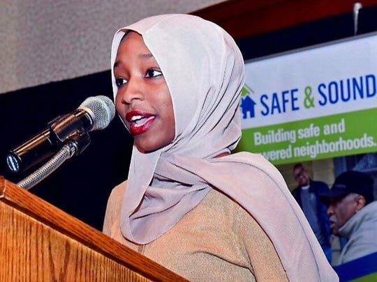 """Zeynab Ali, 18, presents the annual 2016 """"Youth Leader Award"""" for Safe & Sound, a crime prevention group in Milwaukee, on Oct. 13, 2016. She had won the same annual award in the previous year for her activism for safe communities.  Ali is a Kenyan-born Somali refugee, a Rufus King High School senior, and author of a new book on her life journey."""