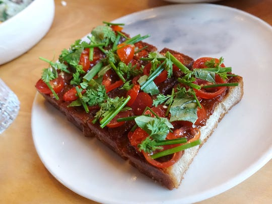 Tomato toast at Theodore Rex in Houston.