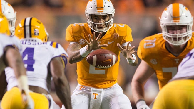 Tennessee quarterback Jarrett Guarantano (2) receives the snap during a game between Tennessee and LSU at Neyland Stadium in Knoxville, Tennessee, on Saturday, Nov. 18, 2017.