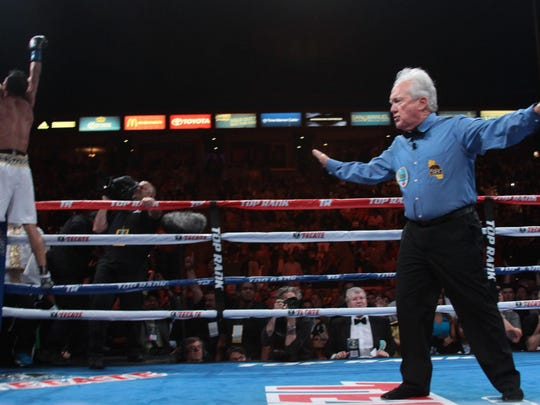Referee Pat Russell ends the fight prematurely between Timothy Bradley and Jessie Vargas at the StubHub Center in Carson on June 27, 2015. Bradley won the interim WBO welterweight bout by unanimous decision.