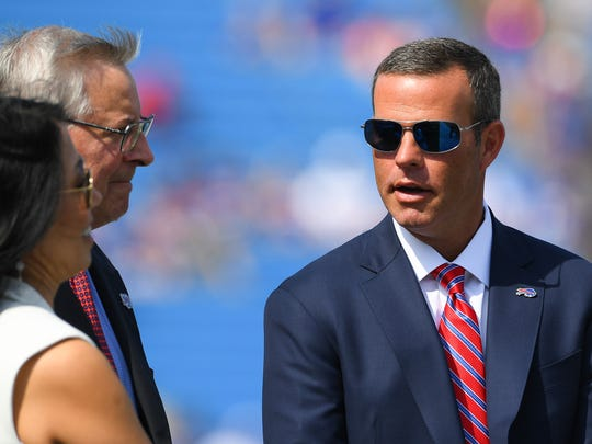 Bills GM Brandon Beane, right, has joined Bills and Sabres owners Terry and Kim Pegula in helping western New York community get through coronavirus pandemic.