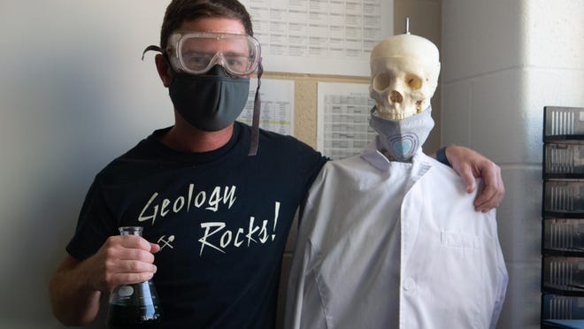 Rob Jackson, left, an eighth-grade science teacher at Seaman Middle School, stands next to a skeleton in his classroom Thursday afternoon. Jackson was one of nine middle school teachers from across the country named to the National STEM Scholar Program.