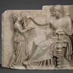 """The """"Grave Naiskos of an Enthroned Woman with an Attendant"""" is on display at the  J. Paul Getty Museum in Malibu, Calif."""