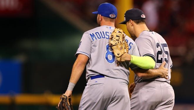American League All-Stars Mike Moustakas, left, of the Kansas City Royals and Mark Teixeira of the New York Yankees celebrate after defeating the National League on July 14, 2015, in Cincinnati, Ohio.