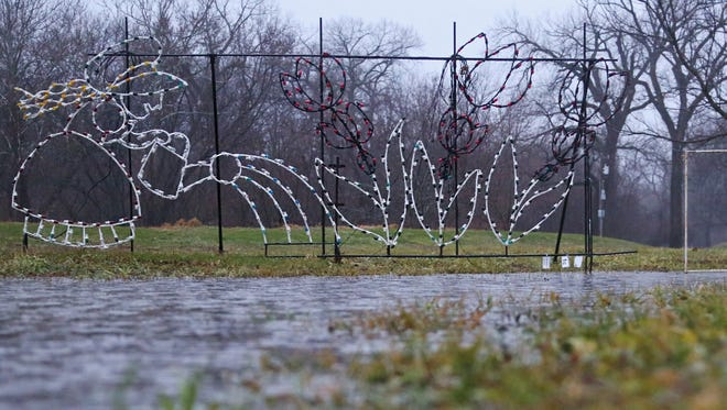 The Jolly Holiday Lights seasonal drive-through light display has been closed for the season because of flooding in Waterworks Park on Sunday, Dec. 13, 2015. The light display is the Make A Wish Foundation Iowa's largest fundraiser of the year.