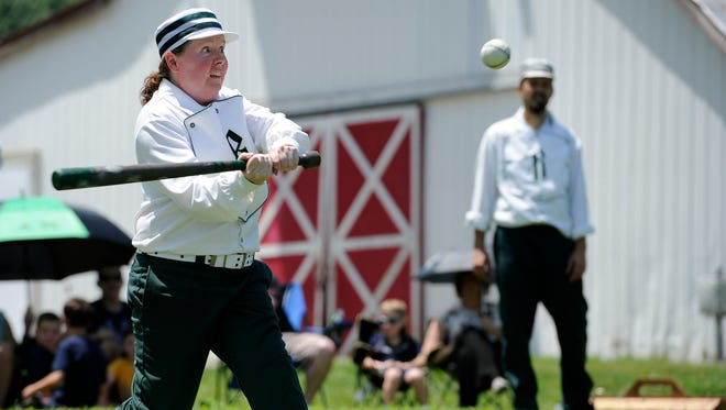"""Brigid """"Ginger"""" Day of the Travellers Club of Brentwood takes a swing at a pitch during their game against the Highland Rim Distillers at Ravenwood Mansion Sunday, July 10, 2016, in Brentwood, Tenn."""