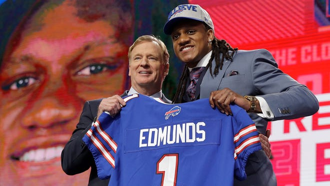 Commissioner Roger Goodell, left, presents Virginia Tech's Tremaine Edmunds with a Buffalo Bills jersey during the first round of the NFL football draft, Thursday, April 26, 2018, in Arlington, Texas. (AP Photo/David J. Phillip)
