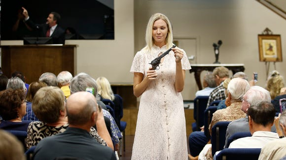 Auction assistant Kayla Wilbur displays Wyatt Earp's Colt .45-caliber revolver was auctioned for $225,000 in April at J. Levine Auction & Appraisal in Scottsdale. This Colt .45-caliber revolver that descendants said Arizona's most famous lawman carried in Tombstone and possibly at the O.K. Corral gunfight. More than 6,000 bidders from 49 countries registered for the auction.