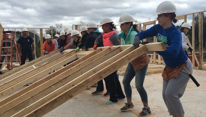 Volunteers with Habitat for Humanity help build a home in Navarre in February 2016. Pensacola Habitat for Humanity will also be rebuilding 16 residences, along with Escambia County, using State Housing Initiatives Partnership funds.