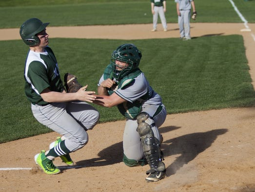 York Catholic's Bryce Floyd is tagged out at the plate