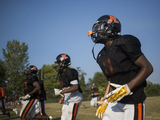 Northeastern's Coby Motley, right, takes part in a