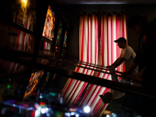 Don Bailey, 45 of West Des Moines plays a game of pinball