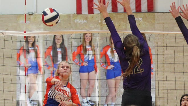 Central High School's Chelsea Weldon hits the ball past Midland High during 2-6A volleyball action Tuesday, Sept. 12, 2017, at Central High School's Babe Didrikson Gym.