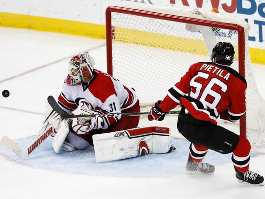 Carolina Hurricanes goalie Eddie Lack, of Sweden, stops