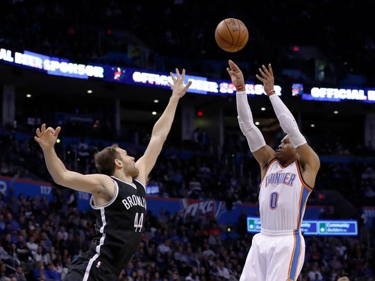 Oklahoma City Thunder guard Russell Westbrook (0) shoots over Brooklyn Nets guard Bojan Bogdanovic (44) during the second half in Oklahoma City, Friday, Nov. 18, 2016.