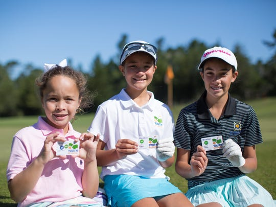 Youth on Course members with their membership cards.