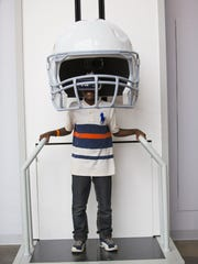 Ajey Niyrnyishu, 12, experiences a virtual reality of what the players see at a kiosk on the concourse at Univerity of Phoenix Stadium before a Cardinals game in 2015.