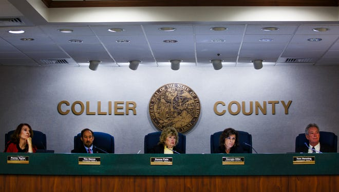 Collier County commissioners, Penny Taylor, Tim Nance, Donna Fiala, Georgia Hiller and Tom Henning listen to arguments for and against the parking exemption for the Beach Box Cafe on Tuesday, Oct. 25, 2016, at the Collier County Commission Chambers in East Naples.