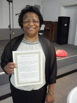 Lillian Shelton poses with a proclamation given to her by Humboldt Mayor Marvin Sikes at a reception held to honor her 33-year teaching career.