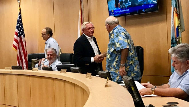 Newly re-elected Marco Island Planning Board Chair Erik Brechnitz (left) and former Vice-Chair Ed Issler shake hands in this file photo.