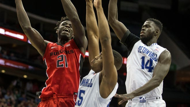 Rutger's Candido Sa shoots over Seton Hall's Rashed Anthony and Ismael Sanogo. Rutgers at Seton Hall 2016 Garden State Hardwood Classic takes place at the Prudential Center.Newark, NJFriday, December 23, 2016.@dhoodhood