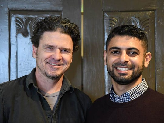 Author Dave Eggers, left, with coffee entrepreneur