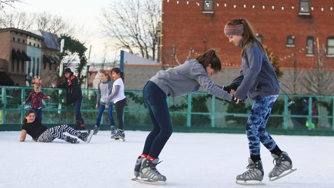 Paris Osteen, left, and friend Laura Andrews hold each other as they skate.