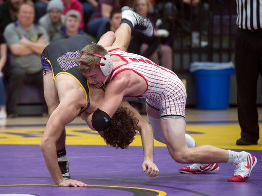 Bermudian Springs' Darren Beall, right, wrestles Boiling