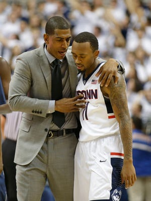 Connecticut head coach Kevin Ollie talks with guard Ryan Boatright during the Huskies' season-opening win Friday against Bryabt.