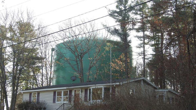 The 65-foot Roots Rock Road water tank is clearly visible from Huckins Avenue in York, Maine, as pictured here in November 2019. A proposal would add cell towers atop the tank.
