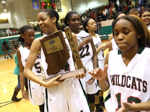 Lawrence North's Destiny Washington holds the sectional trophy after defeating Roncalli during the sectional finals at Arsenal Tech High School Saturday February 15, 2014. Lawrence North won 45-41.