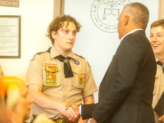 Millville Mayor Michael Santiago congratulates members of Boy Scout Troop 4 Wednesday night at the City Commission meeting.