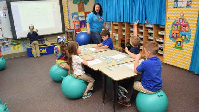 Buckeye Elementary School first-grade teacher Tiphanie Sumrall teaches math as students in her class sit on fitness balls.