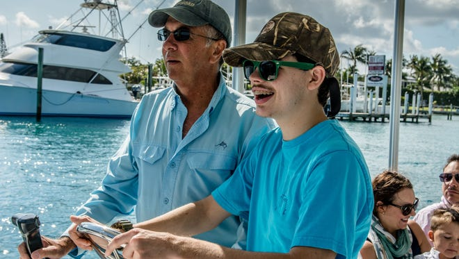 Hunter Puglise loves boating. John Saunders, with Jupiter Water Taxi, recently took him and his family out for a fun day on the water.