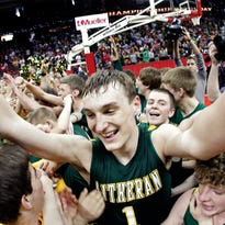 Sheboygan Area Lutheran High School's #1 Sam Dekker is embraced by fans after sinking the winning three point shot against Racine Lutheran High School during their championship game at the WIAA boys state basketball tournament in Madison Wis. on Saturday March 17,  2012.