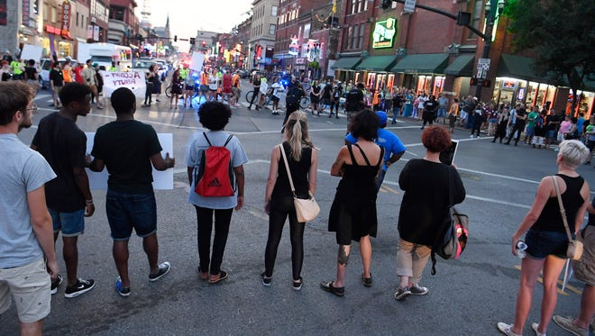 Black Lives Matter protesters shut down Broadway at Second Avenue Friday, July 13, 2018, in Nashville, Tenn.
