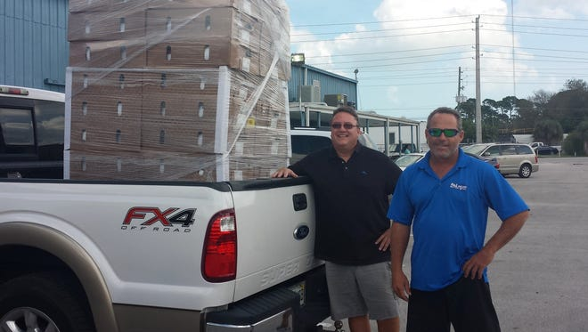 Chris Rawe and Doug Miller deliver a truck load of turkeys to Turkey Drop in St. Lucie County in 2014.